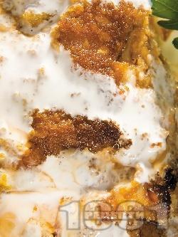 Пържена панирана бяла риба мерлуза в сметанов сос - снимка на рецептата